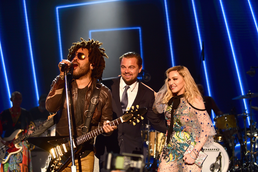 SAINT-TROPEZ, FRANCE - JULY 26: (L-R) Lenny Kravitz, Leonardo DiCaprio and Madonna are seen on stage during the Leonardo DiCaprio Foundation 4th Annual Saint-Tropez Gala at Domaine Bertaud Belieu on July 26, 2017 in Saint-Tropez, France. (Photo by Anthony Ghnassia/Getty Images for LDC Foundation) *** Local Caption *** Lenny Kravitz; Tobey Maguire; Leonardo DiCaprio